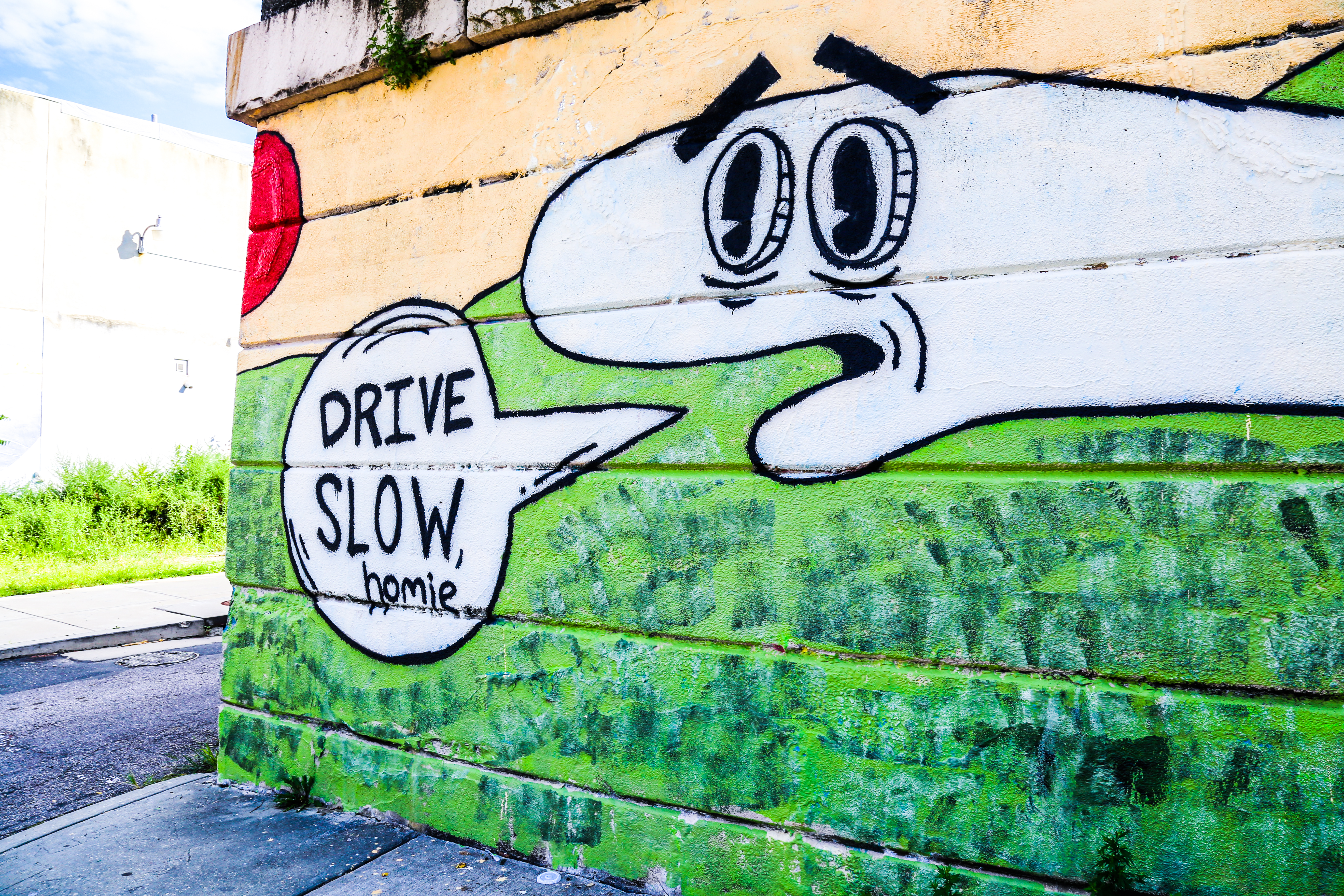 A New Sockpuppet Piece By Butter And Salmon At Norris Street And Trenton Avenue Pleads With Drivers In Fishtown To Slow Down